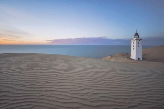 lighthouse on sand dunes